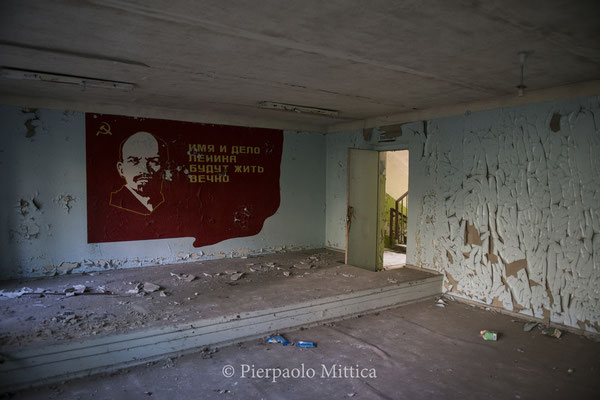 a portrait of Lenin insiide a building in the ghost town of Pripyat