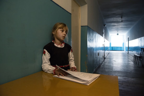 A girl with the results of examinations carried out at the Ivankiv hospital by Professor Bandazhevsky's team