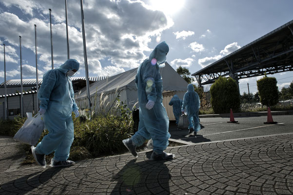 Workers coming back from their shift at the Fukushima nuclear power plant, J Village, Naraha.