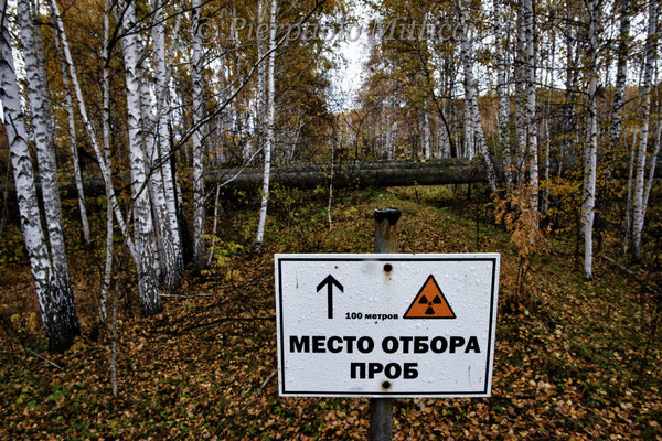 The sign warns: detection point for the contamination. Road to Lake Karachay, Novogorny
