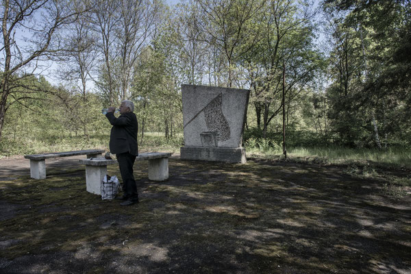 Former local resident visiting the graves of his deceased in the Chernobyl city cemetery.