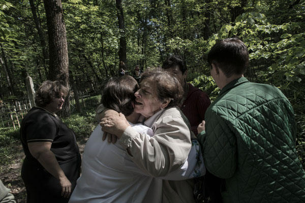 Former inhabitants of the area meet at the Chernobyl cemetery.