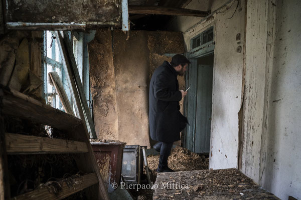A jew while exploring an abandoned house in the evacuated part of Chernobyl City