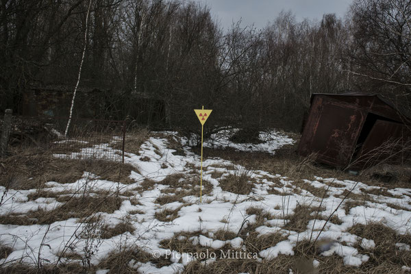 a radiation warning sign in the Chernobyl exclusion Zone