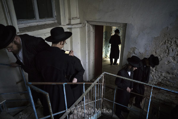 Jews while exploring the abandoned Chernobyl Synagogue.