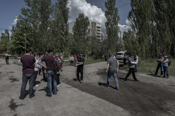 Former inhabitants of the city of Pripyat waiting for permission to enter the city.