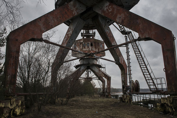 Abandoned cranes in the Chernobyl river port. Chernobyl Exclusion Zone.