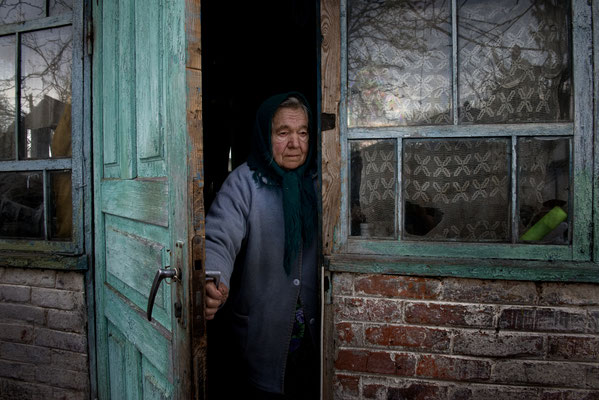 Maria Semenyuk, 78 years old, in her home waiting for her husband Ivan. On May, 17th 2016 Maria has died after living all her life in her home. She was buried in Paryshev cemetery. Paryshev, Chernobyl Exclusion Zone