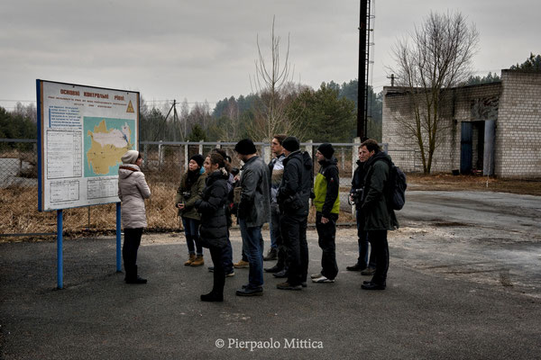 Explanation of the guide in front of the exclusion zone's map, check point of the 30 kilometer exclusion zone