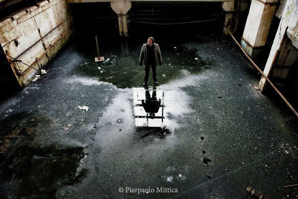 Yuriy Tatarchuck on ice inside the abandoned electronics factory. The whole basement is flooded and during the winter becomes a slab of ice, where it is possible to walk. Pripyat, exclusion zone