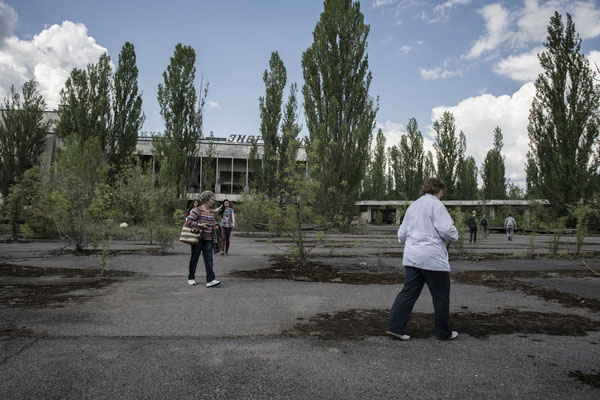 Former inhabitants of the city of Pripyat while strolling in the main square of their city.
