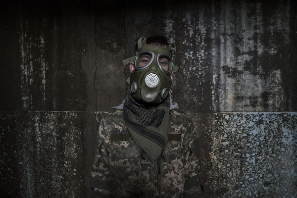 A stalker playing with a mock gas mask