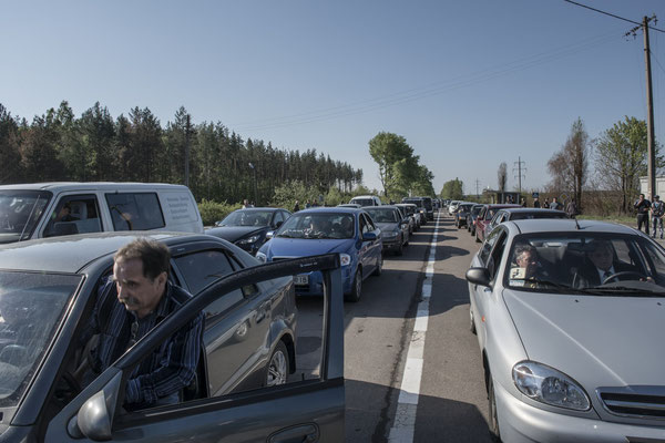 Former inhabitants queuing for checks to enter the Chernobyl exclusion zone.