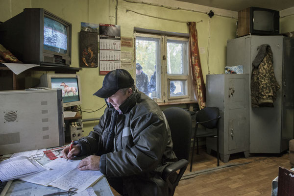 Valeri at the 10 km checkpoint where he works on the radioactivity control of people and cars passing daily through the check point. Chernobyl exclusion zone