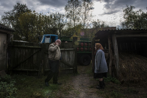 Maria Semenyuk while purchasing a gas bottle from a seller of the zone. Paryshev, Chernobyl Exclusion Zone