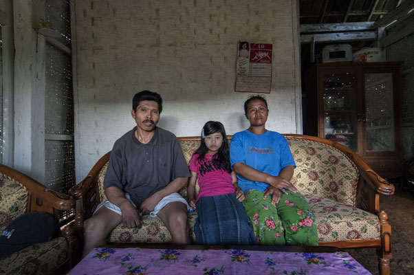 Sutikno with his son and wifeat home, he lives in Tanah los village