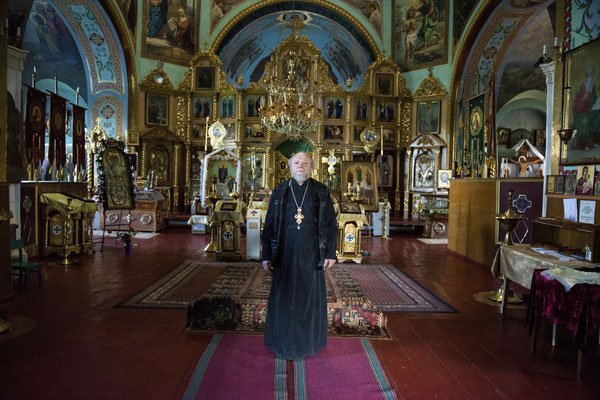 Priest Nikolai in the Orthodox church in the town of Chernobyl. At the time of the evacuation in 1986 he refused to leave. Since then he has always lived in Chernobyl town continuing to celebrate mass for the population