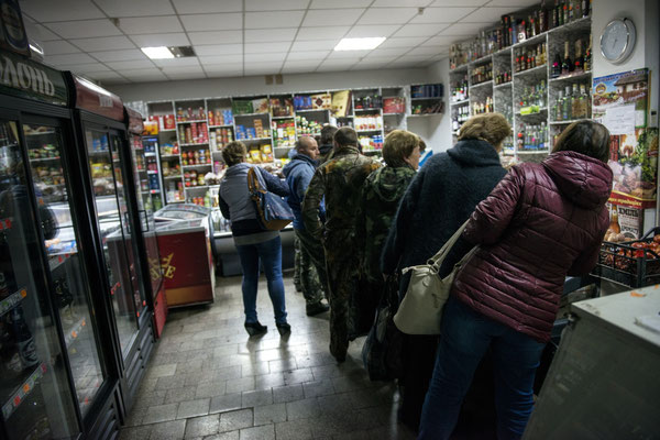 a Queue in a shop in Chernobyl town. In the city there are 4 shops that sell necessities such as food and drink.