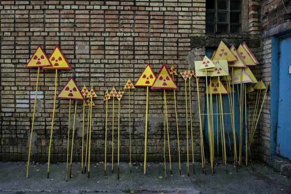 Fresh painted radiation warning signs ready to be put around the zone, Pripyat city. In the ghost  town of Pripyat, inside Chernobyl Exclusion Zone, there is a factory where workers paint the radiation warning signs worn by time and weather.