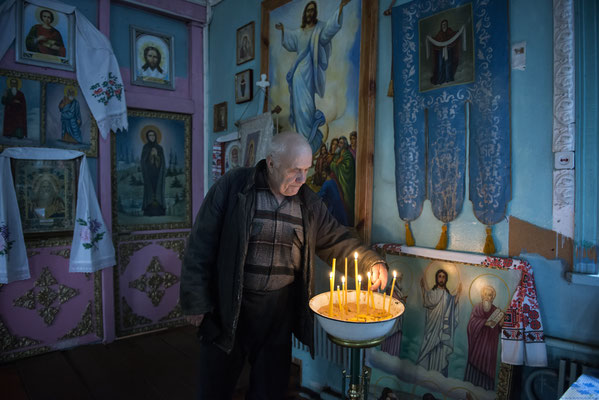 Viktor Petrovich Lukanjenko, 75 years old in the small orthodox church of the village of Marjanovka, Chernobyl Exclusion Zone