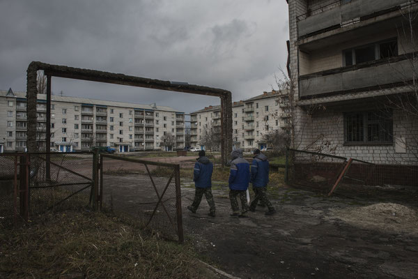 Chernobyl town. Workers return to their accomodation after their shift.