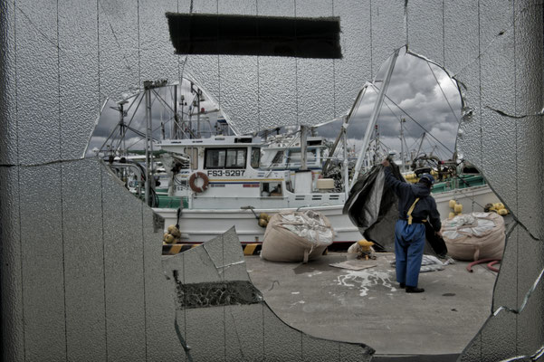 """Today It is still forbidden to fish on the Fukushima sea and local fishermen have been """"recycled"""" by the government and now with their vessels clean up the sea by the tsunami debris. Soma port"""