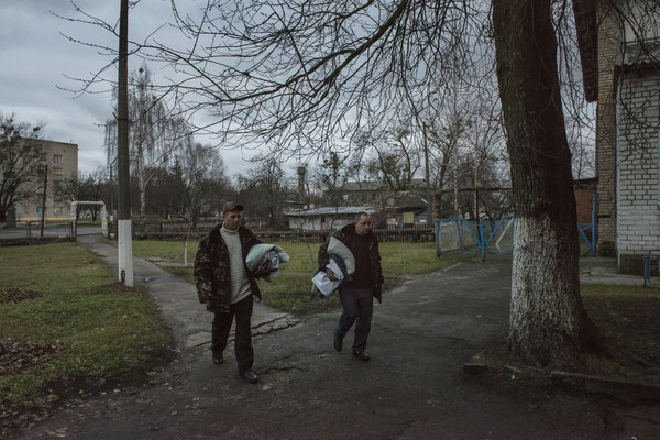 Chernobyl town. Workers return to their accomodation after their shift. Chernobyl Exclusion Zone.