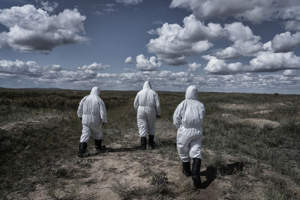 Scientists of the Kurchatov nuclear center wearing protective suits Inside the polygon, while going to ground zero, where the first atomic bomb was exploded on 1949.