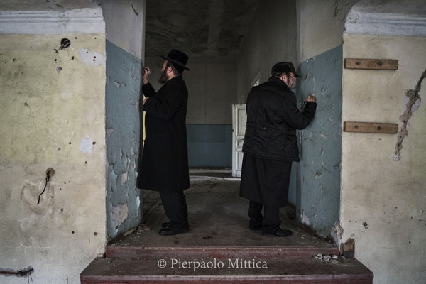 jewish while writing their names as a memory inside the former Synagogue of Chernobyl.