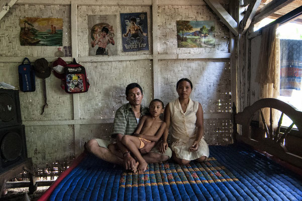 Ribut Santoso with his son and wife at home. They live in Sumberwatu village