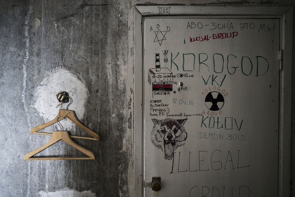 Hangers and graffiti in one of the apartments occupied by stalkers.