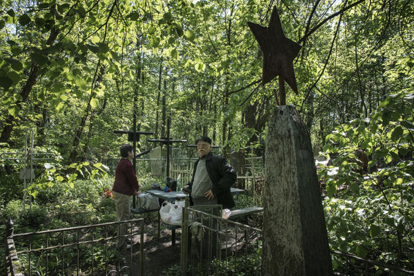 Former inhabitants visiting the graves of their deceased in the city of Chernobyl.