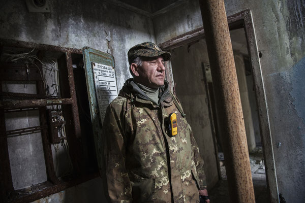 Vladimir, a former resident of the city of Pripyat, in front of the apartment where he lived with his parents before the accident. Pripyat.