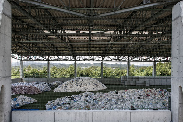 """Warehouse for stocking radioactive suits of the workers, J village, the Tepco headquarter, Fukushima """"No-Go Zone"""", Japan."""