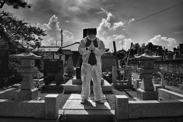 "Mister Matsumoto, Yakuza member and Tepco contractor is praying on his family grave, Fukushima ""No-Go Zone"", Japan."