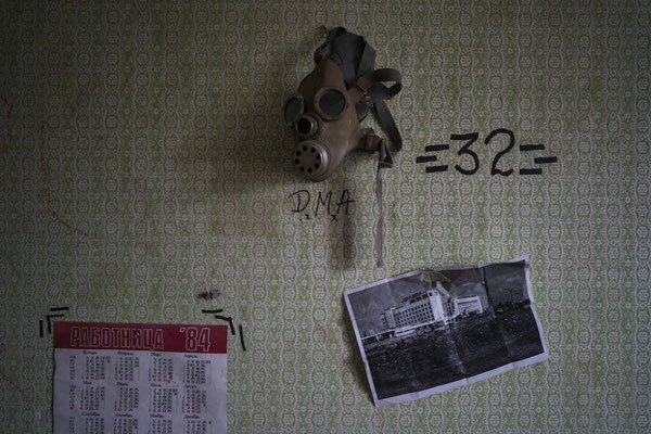 A gas mask hanged on a wall of an apartment occupied by stalkers in the ghost town of Pripyat.