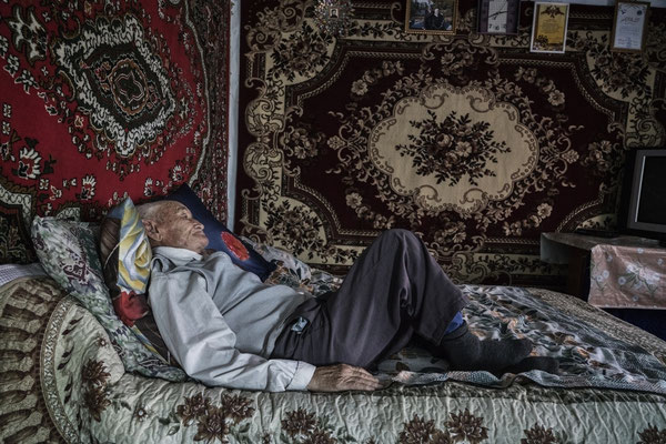 Naurizbek Umarov 85 years old lies on his bed in his home in the contaminated village of Bodene. He is a witness of the atomic explosions and lives in the contaminated village of Bodene situated close to the border of the Polygon.