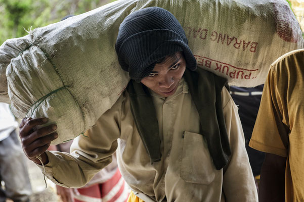 Mustain, lives Gumuk batur village, he is load bearer who cant use bamboo basket to carry sulfur