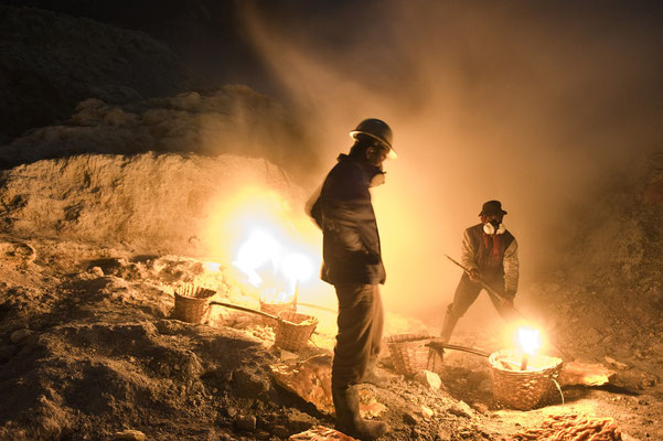 miners while collecting chunks of sulphur in the volcano crater during his night shift