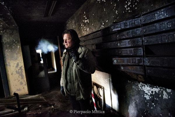Yuriy Tatarchuck inside a building while waiting for tourists going around