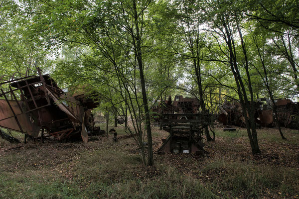Farm machinery swamped by nature in the abandoned village of Kopachi, in the Chernobyl exclusion zone.