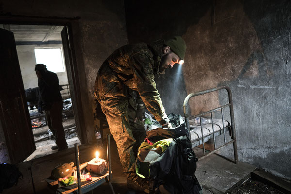 Jimmy preparing for the night in an old pig-shed. This abandoned building is another stop along the way to Pripyat, 45 km from the border of the Zone of exclusion and 15 from Pripyat