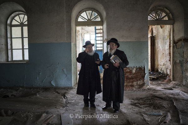Yitz Twersky and Rabbi Leibel Sirkes inside the former synagogue in Chernobyl City