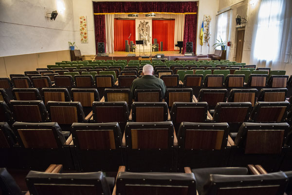 Chernobyl town. A man waits for a show to begin at the House of Culture, where events such as concerts, recitals, conferences and meetings are organize for the entertainment of the population.