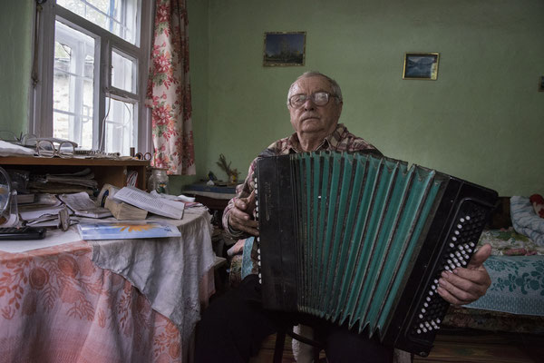 Chernobyl town. Mihail was the music teacher at the school in Chernobyl before the incident and now a pensioner, he has always lived in Chernobyl