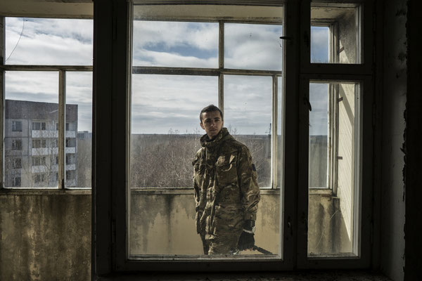 Vadim, of the Sector Zone group, in his apartment in the ghost town of Pripyat.