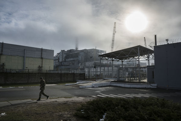The Chernobyl plant with the old sarcophagus, two months prior to the installation of the new safe confinement