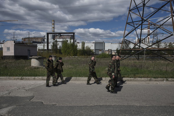 Chernobyl, workers head to the canteen at the nuclear power plant for their lunch break. Their route takes them past reactor 4.