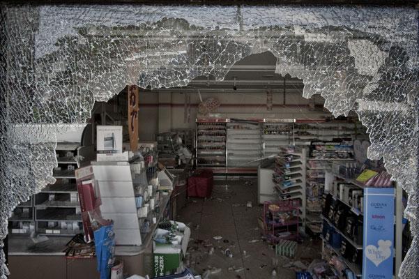 "Market devastated by thieves, Futaba city, Fukushima ""No-Go Zone"", Japan."