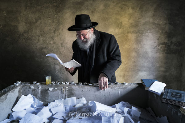 Yitz Twersky while praying and crying on the tomb of his ancestor and the Hassidic movement founder, Grand Rabbi Menachem Nachum Twersky Admur of Chernobyl.